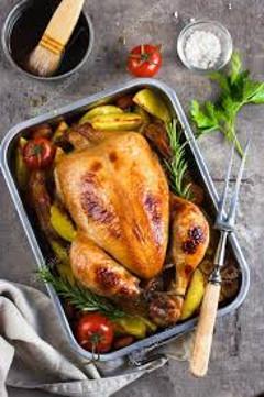 celá kura v pekáči so zeleninou
